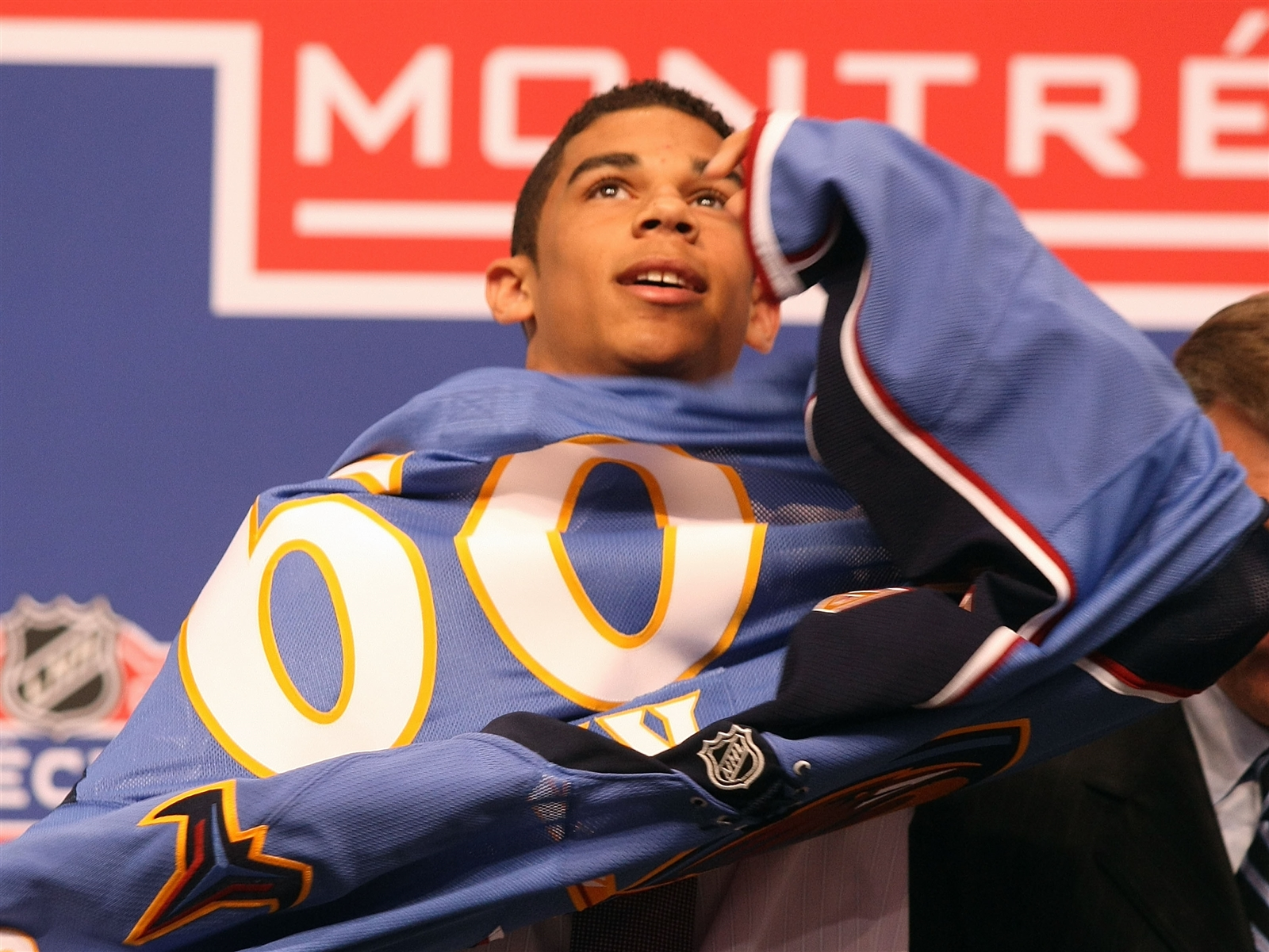 Evander Kane puts on his new Atlanta Thrashers sweater after he was picked No. 4 overall by the Thrashers during the first round of the 2009 NHL Entry Draft at the Bell Centre on June 26, 2009, in Montreal, Quebec.