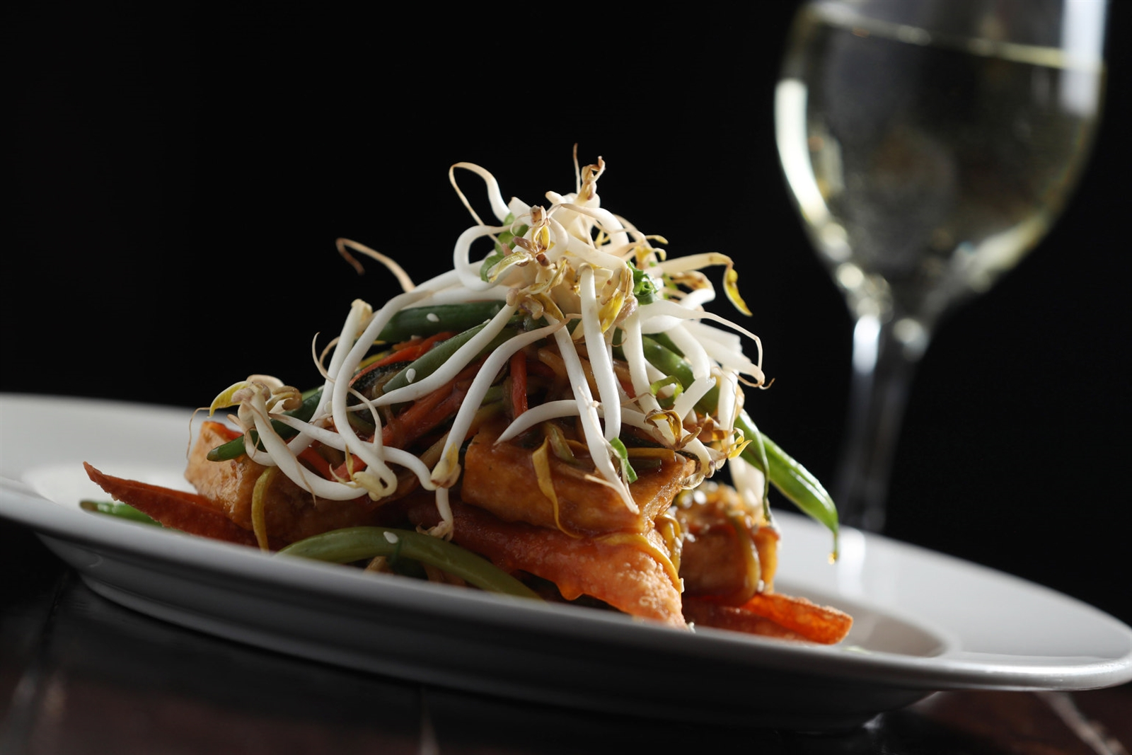 The tofu stack is fried tofu layered with bean sprouts, cabbage, vegetables and crispy wontons with sesame-soy jus.