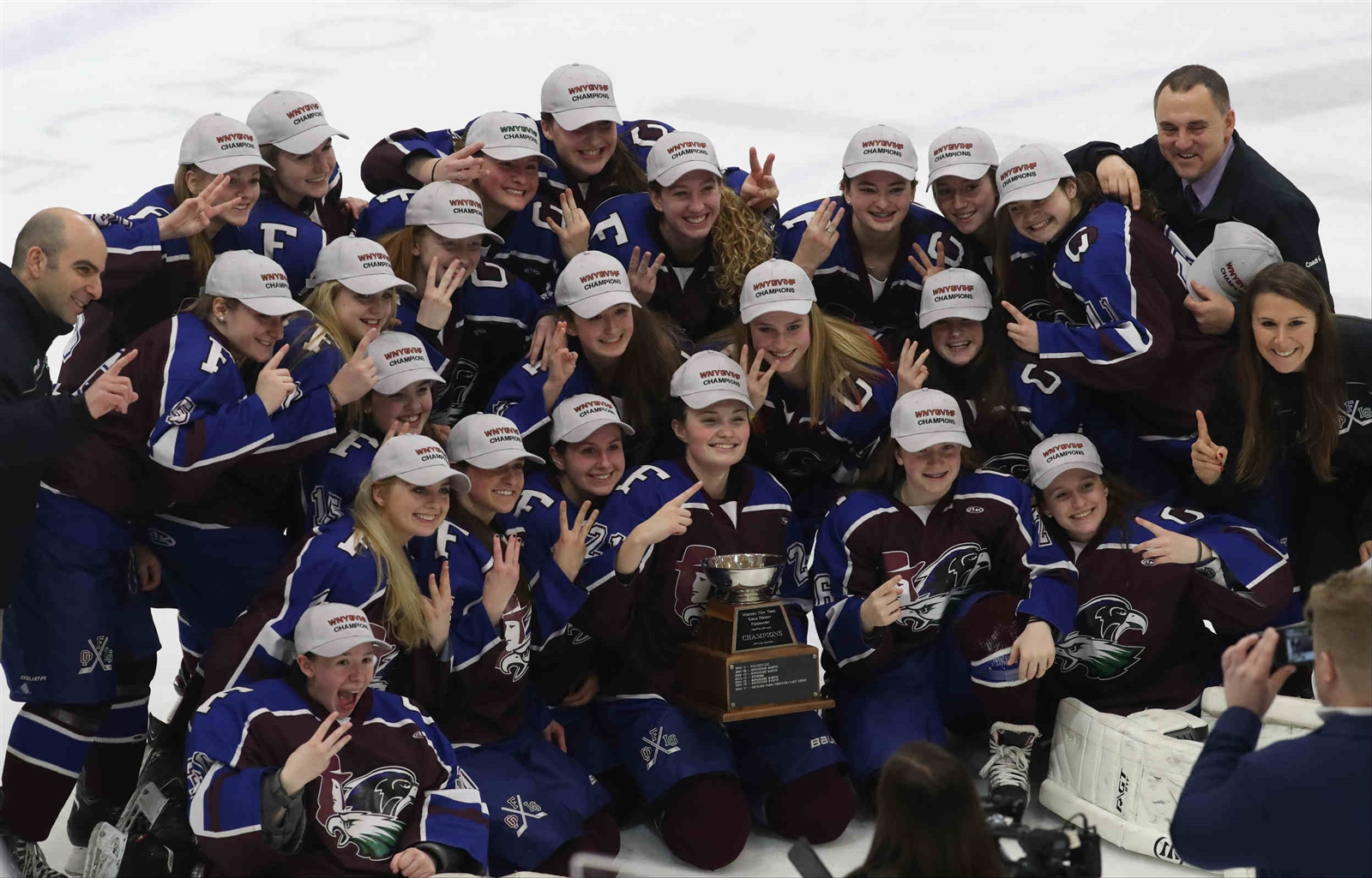 FLOP's Gabby DeMeo holds up the championship cup after her team beat Clarence/Amherst/SH 3-1 for the 2018 Girls Ice Hockey Federation Championship at the HarborCenter.