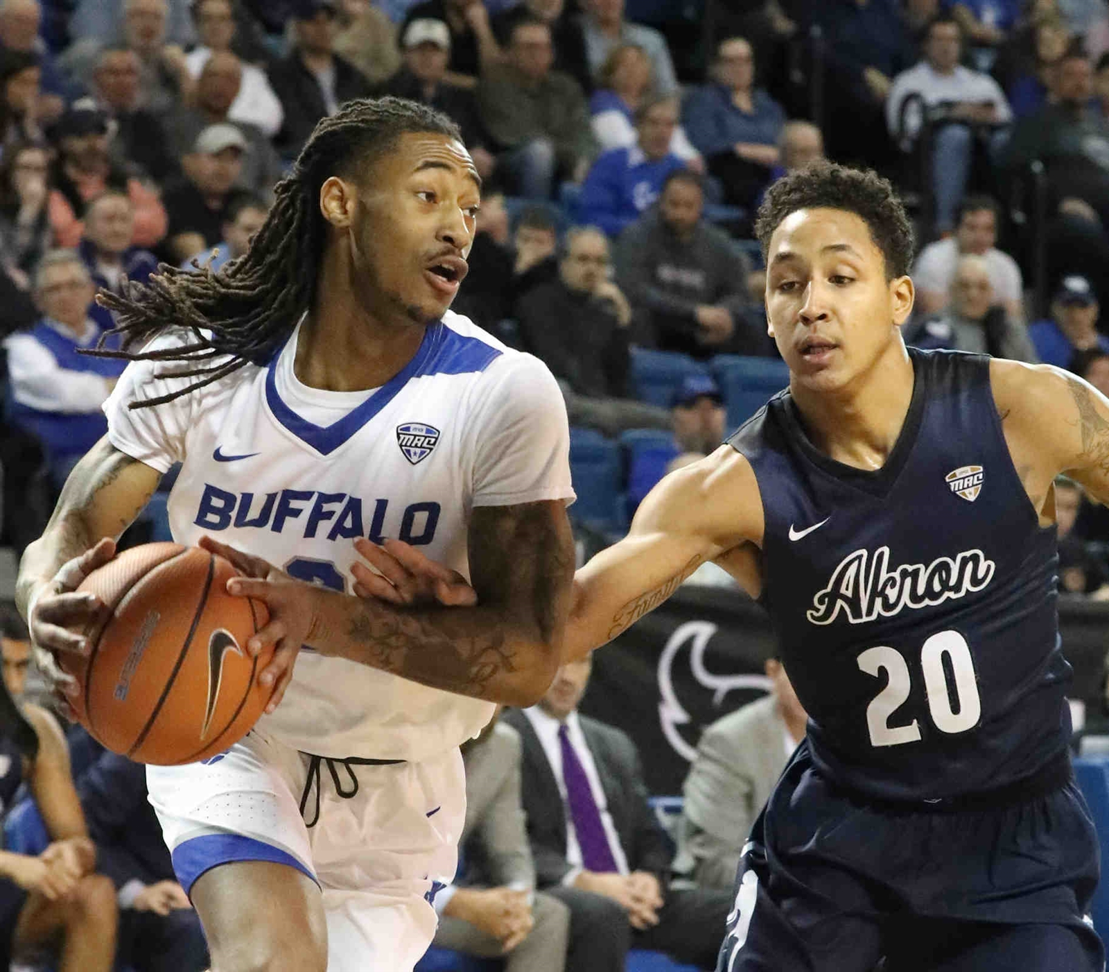 Buffalo Bulls guard James Reese (0) is fouled by Akron Zips guard Eric Parrish (20) in the first half.