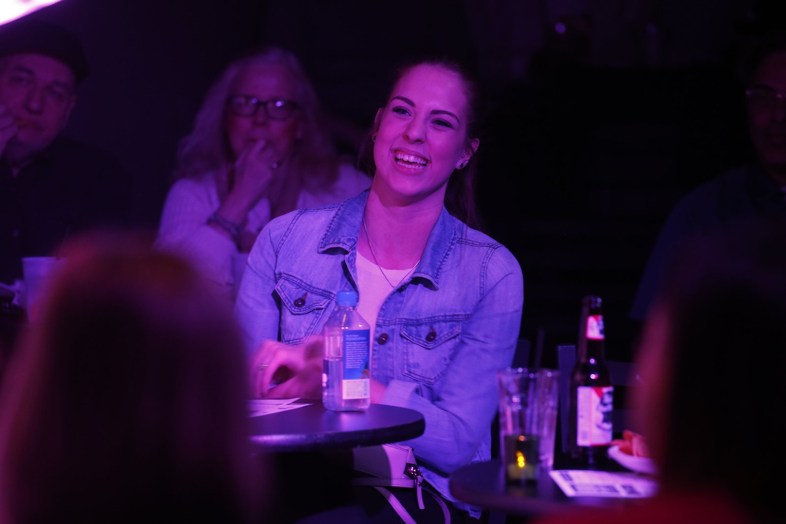 Erin Griffiths, girlfriend of student comedian Austin Hodkinson, listens to his set.