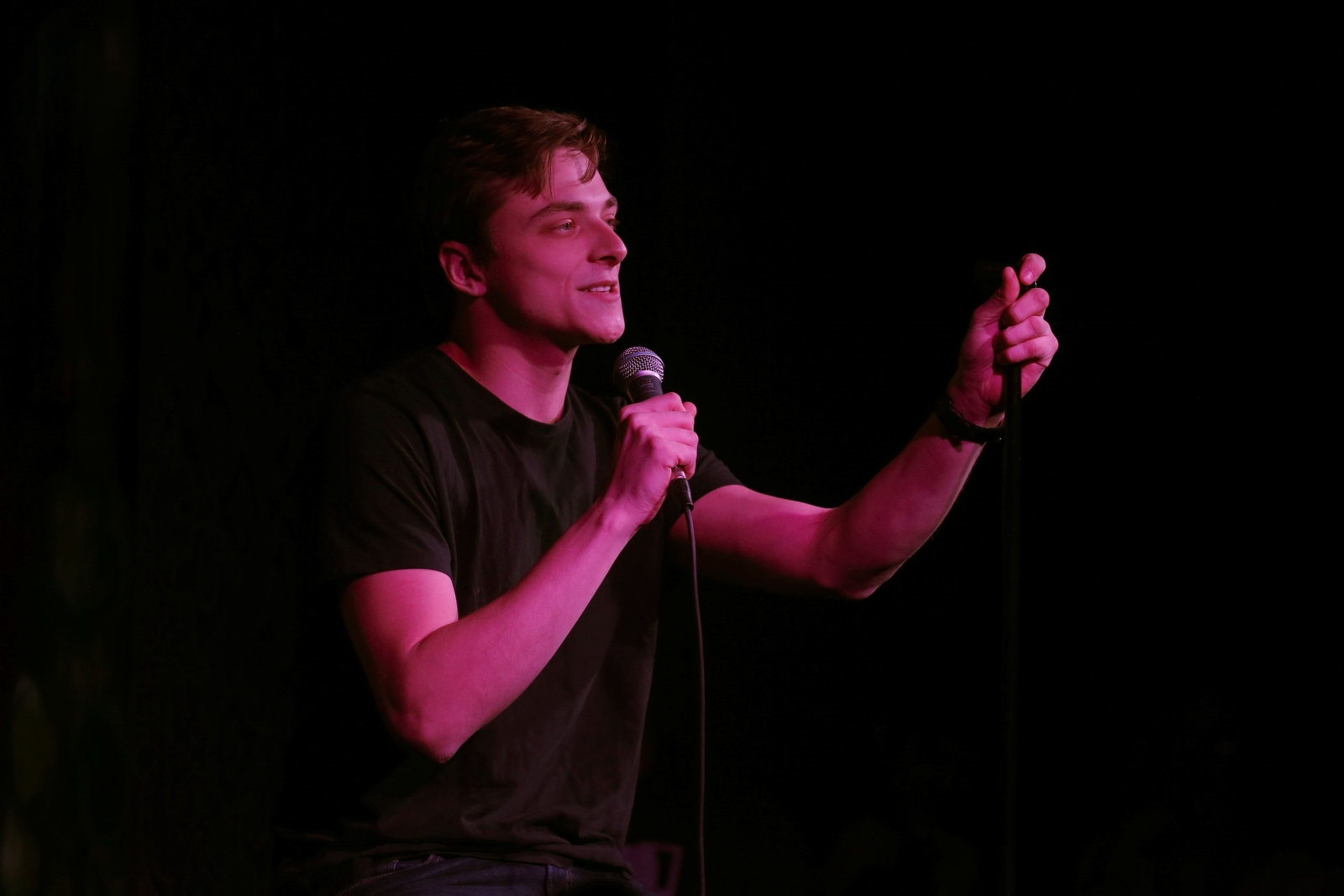 Student comedian Austin Hodkinson, a Canadian firefighter by day, does his set.