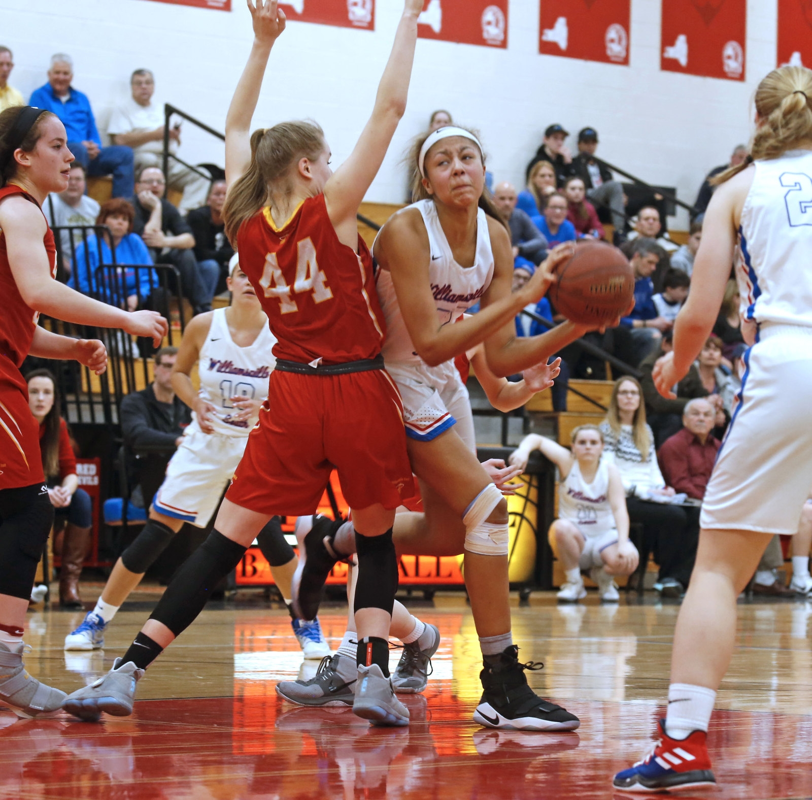 South's Amaria DeBerry (42) still makes the basket as East's Madeline Reid (44) tries to contain her on the approach.