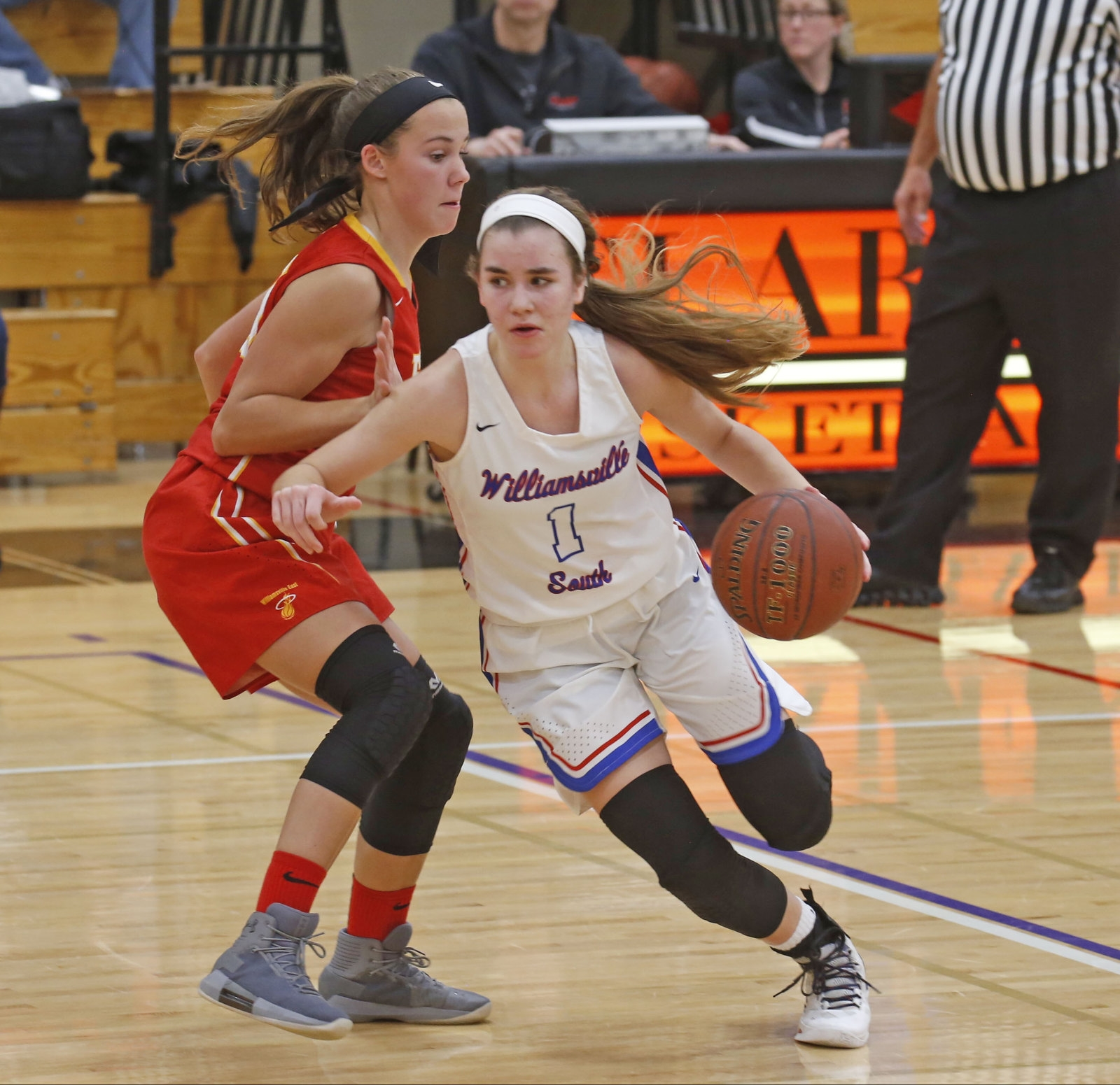 East's Courtney Mclay (20) tries to hold off South's Hannah Dolan (1).