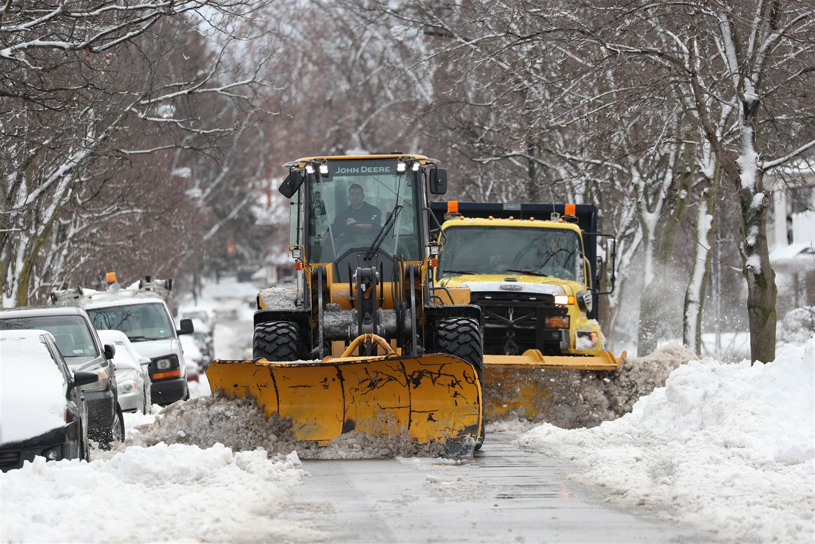 Snow is cleared from Shoshone Street in Buffalo.