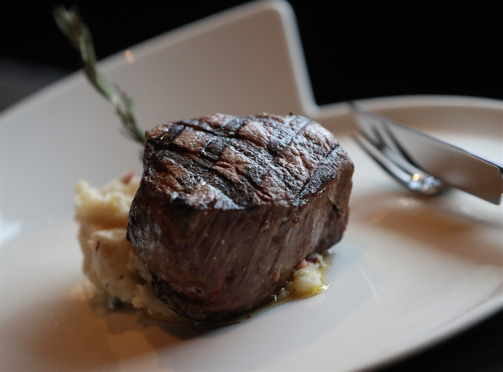 The filet mignon is a prime 8-ounce tenderloin of Black Angus beef from Roseda Farm in Monkton, Md. The meat is cast-iron roasted with herbs and sea salt.