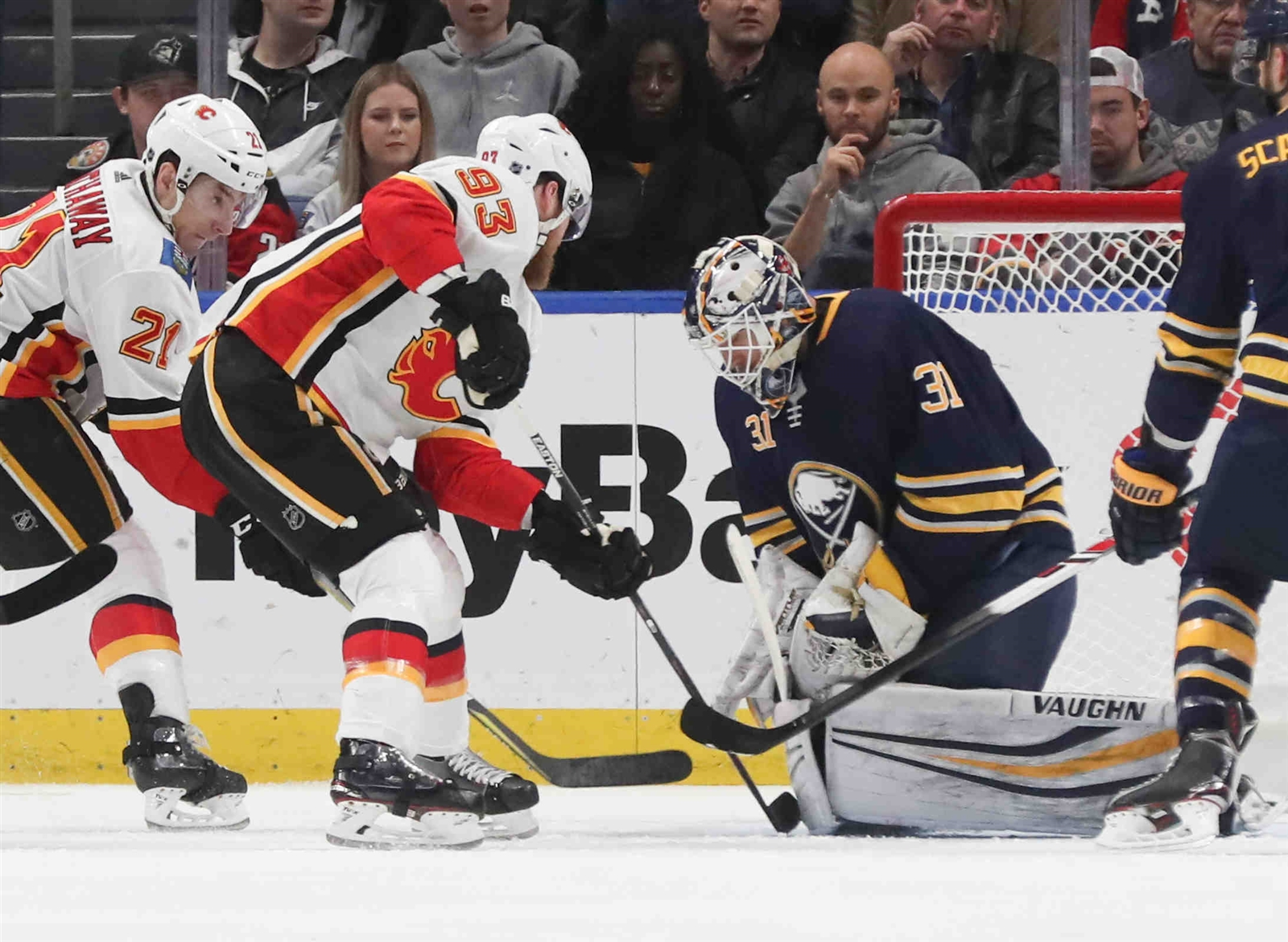 Calgary Flames center Sam Bennett (93) scores  goal against Buffalo Sabres goaltender Chad Johnson (31) in the first period.