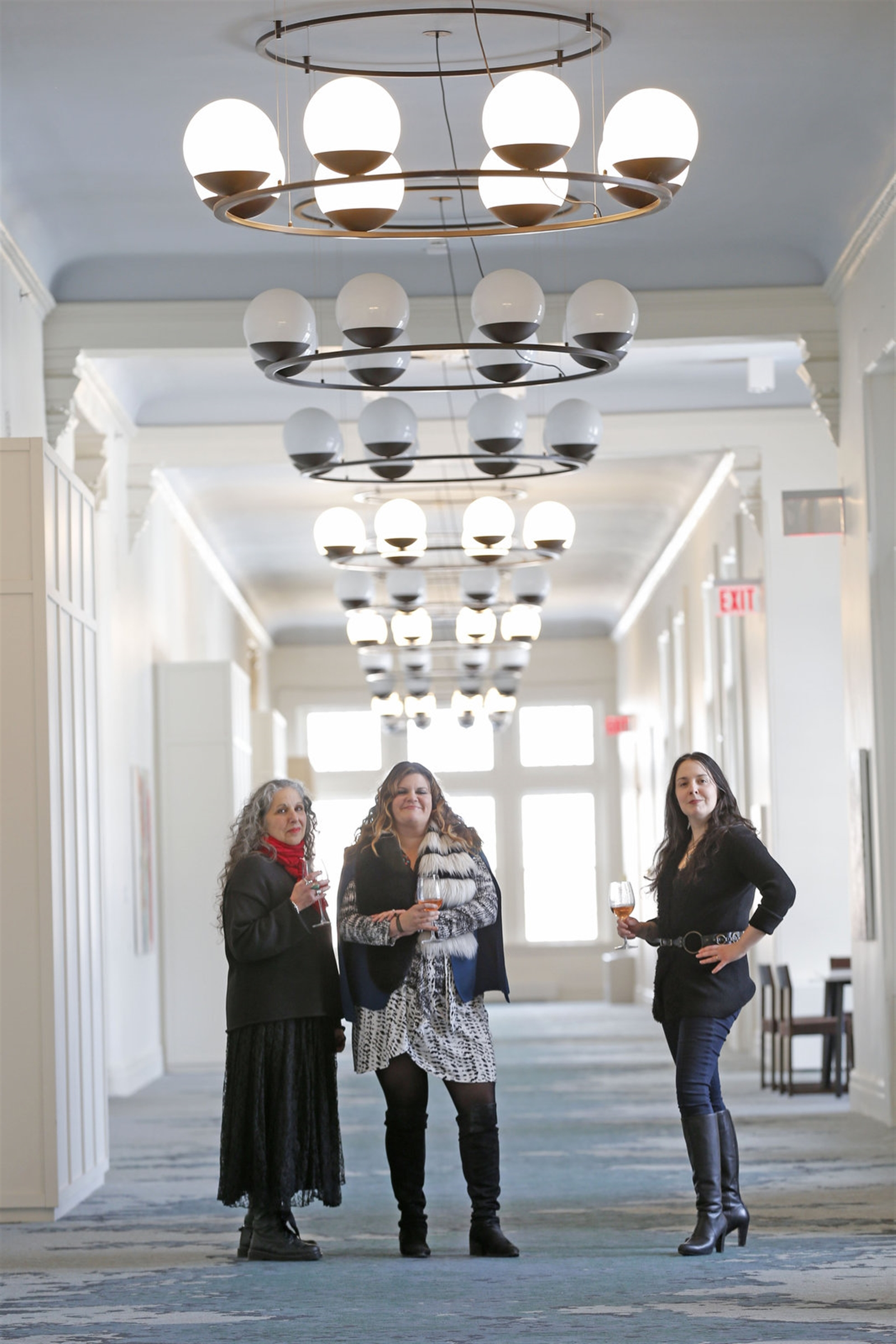 Curators, from left,  Elisabeth Samuels, Emily Tucker and Anna Kaplan, with locally based  Resource:Art collaborative were responsible for choosing the art for the Corridors Gallery at Hotel Henry.