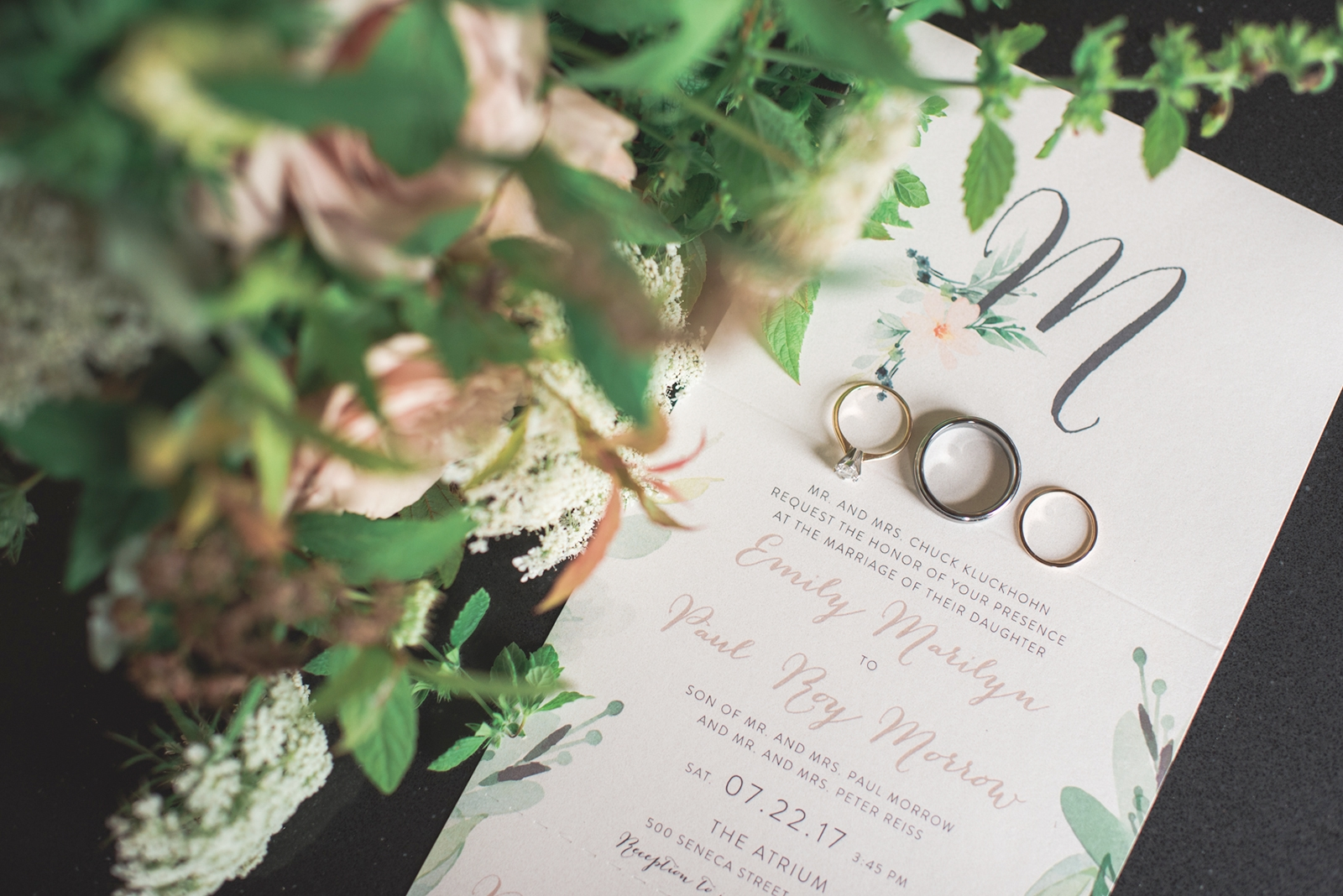 The couple's invitations are  from Krepe-Kraft on Elmwood, and the rings from Jared.