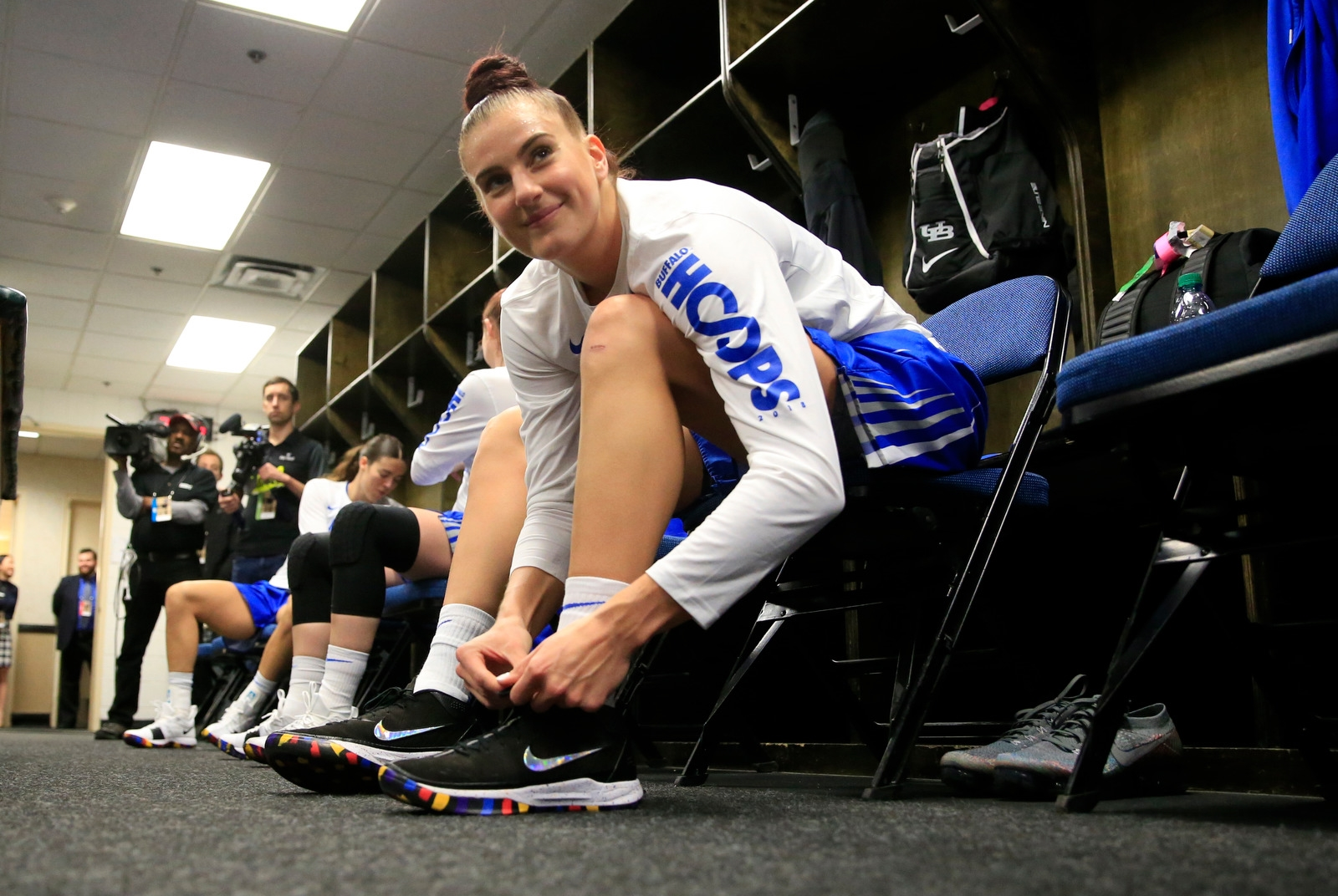 Buffalo center Cassie Oursler ties her shoelaces prior to playing South Carolina in the NCAA women's college basketball tournament regional semifinal at the Times Union Center on Saturday March 24, 2018.