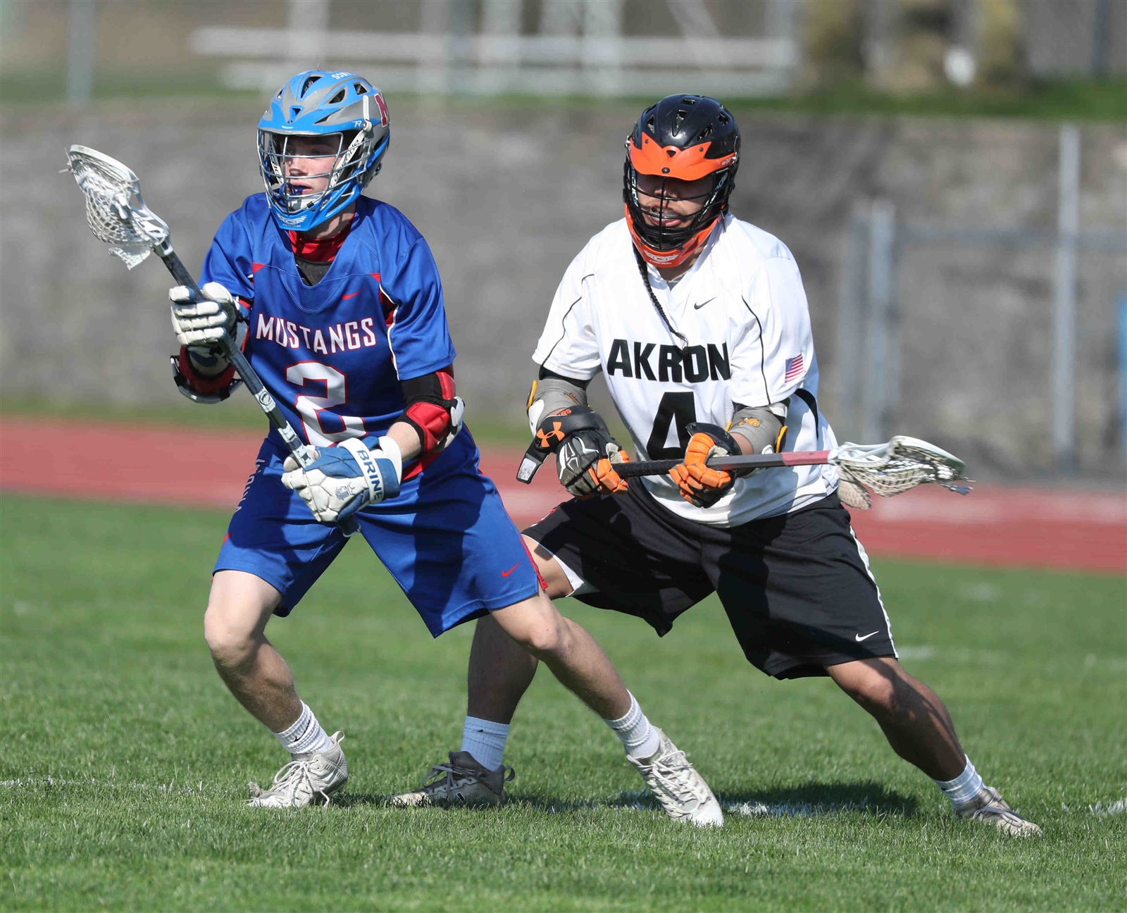 Owen Hill of Akron battles Mason Lewis of Medina for the ball.