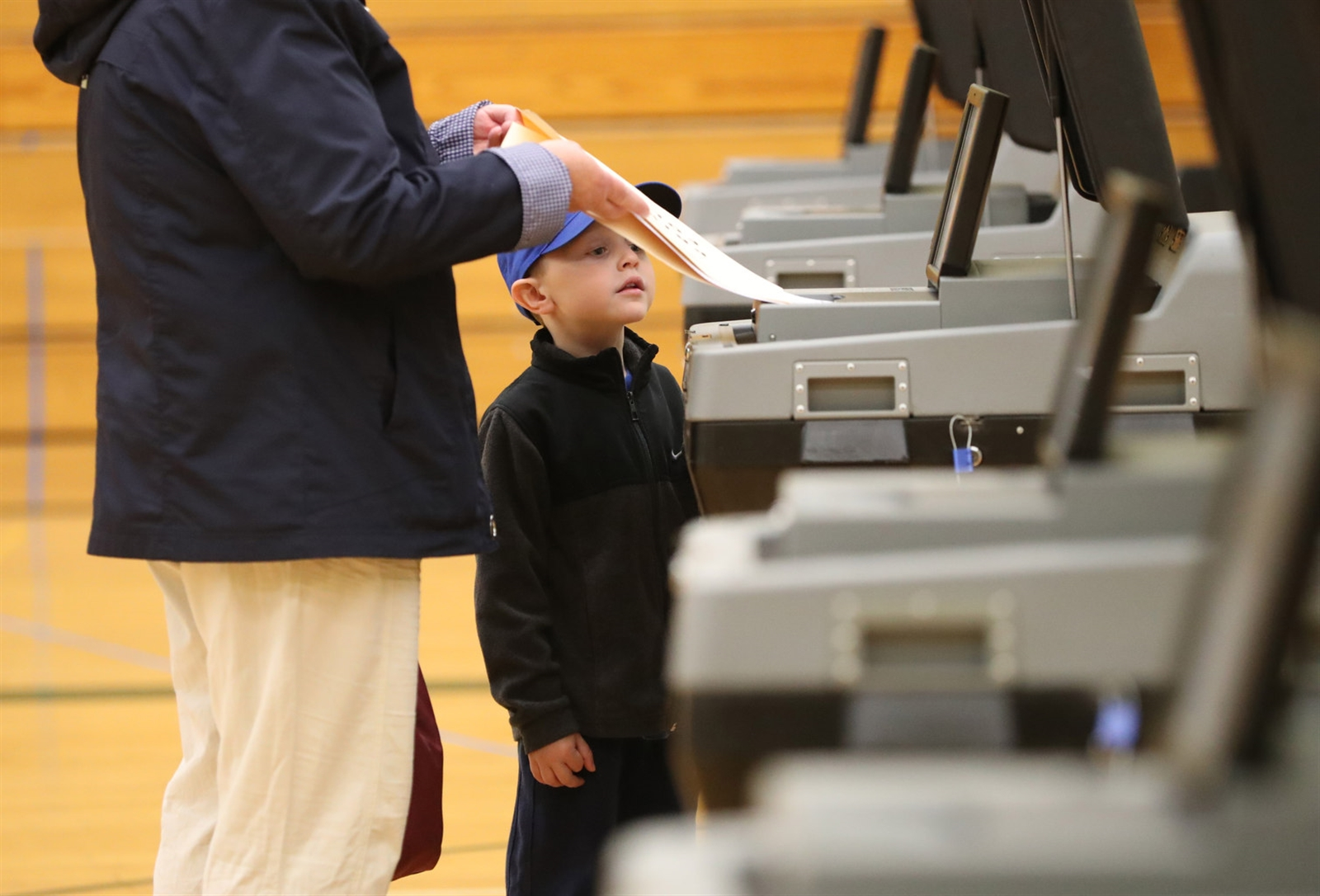 Jake Buesink, 5, watches as his grandmother Barb Burgstahler's vote is scanned at Williamsville North High School on May 15.