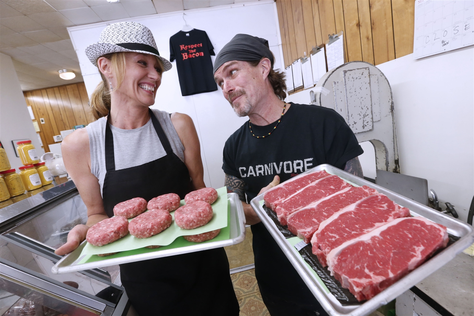 Butcher Joe Kennedy, right, and wife Beth prepare to put  steak-burgers and steaks in the store's case.