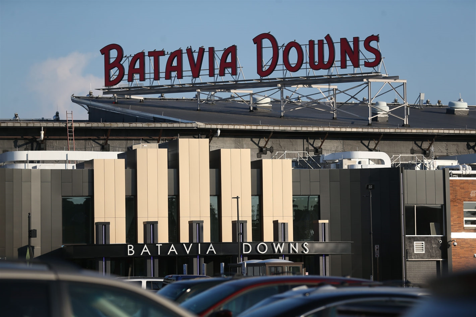 Crowds come out for a Wednesday night of horse racing at Batavia Downs, the oldest lighted harness track in the US.