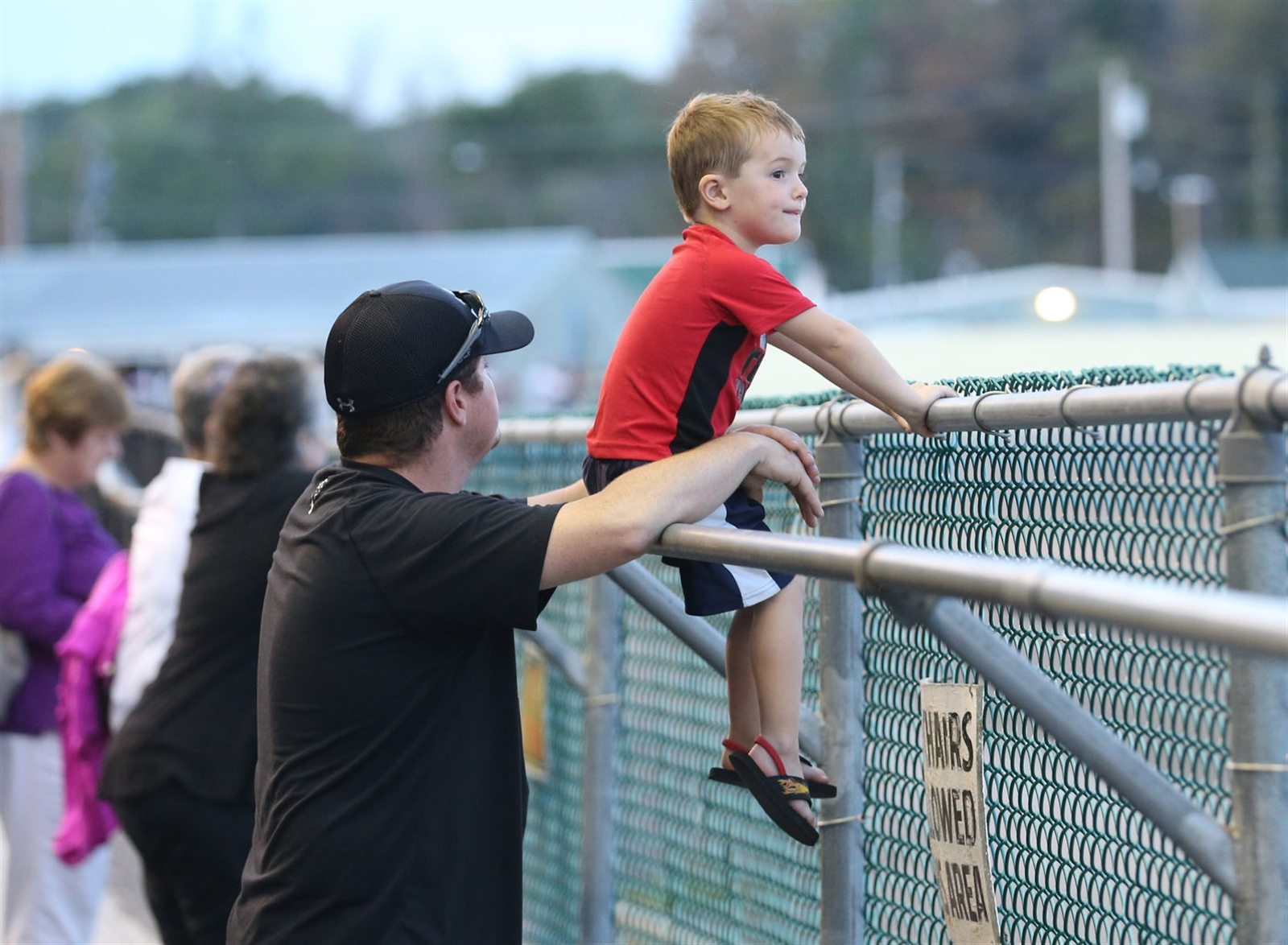 Jay Platten with his son Connor, 3, watching a race at Batavia Downs.