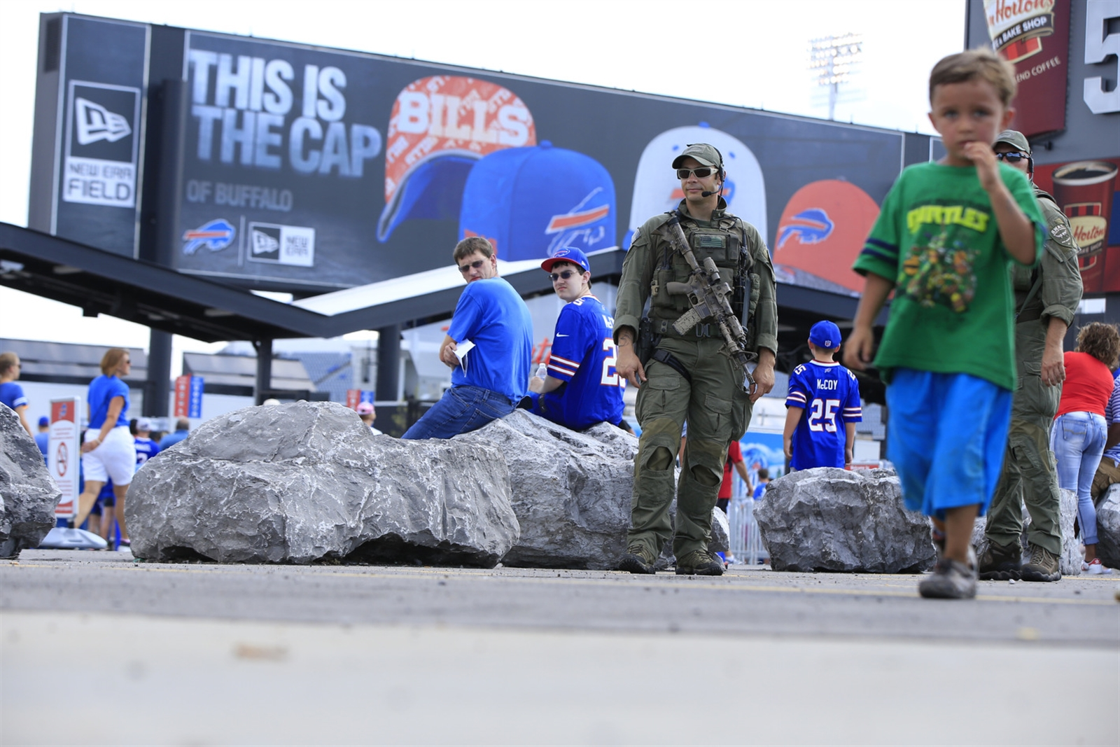 Erie County SWAT team members Ben Pisa and Matt Noecker look over a portion of the perimiter of New Era Field prior to the Buffalo Bills and New York Giants game on Saturday, Aug. 20, 2016.