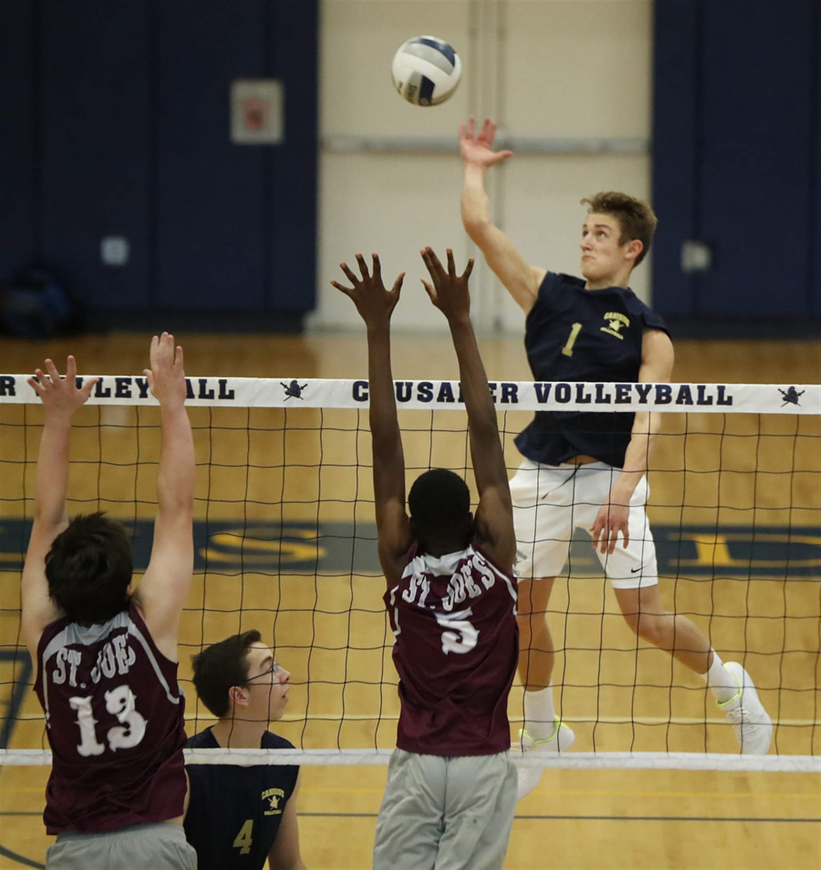 Canisius's Charles Palka returns a ball against St. Joe's during the second game at Canisius High School on Thursday, Sept. 22, 2016.  (Harry Scull Jr./Buffalo News)