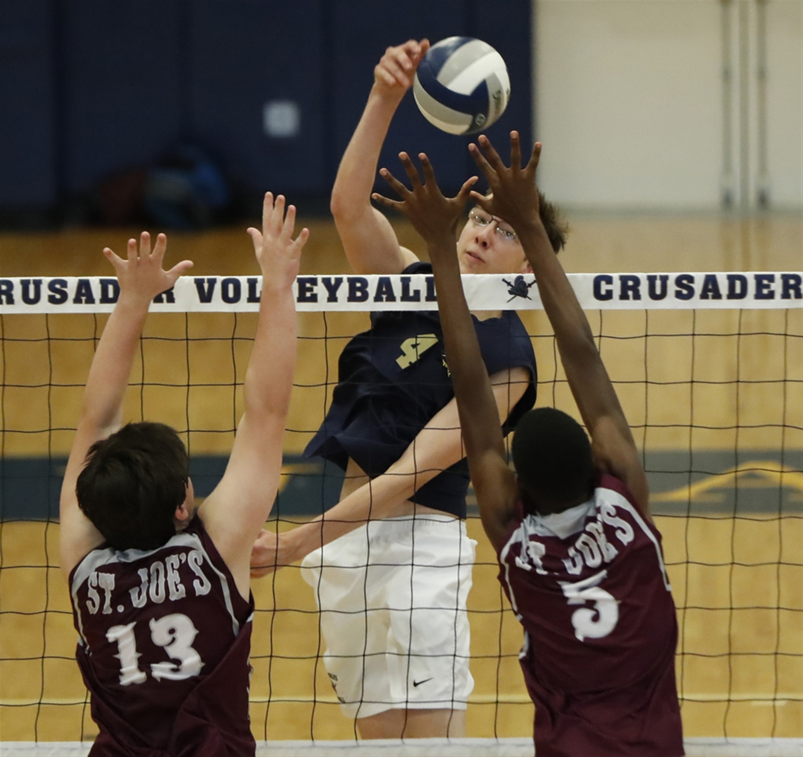 Canisius' Matt Donnelly returns a ball against  St. Joe's during the second game at Canisius High School on Thursday, Sept. 22, 2016.  (Harry Scull Jr./Buffalo News)