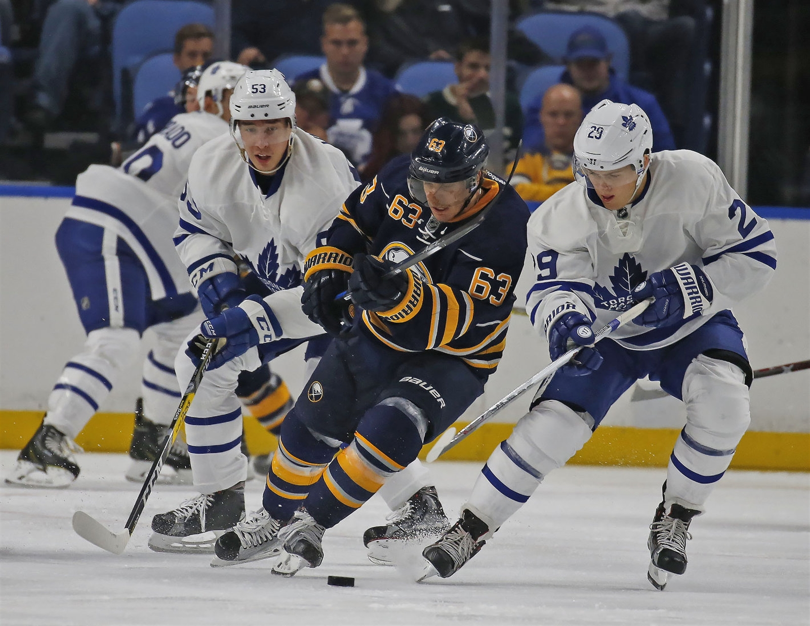 Buffalo's Tyler Ennis (63) tries to get to the puck before Toronto's William Nylander, right, in NHL action at KeyBank Center on  Friday, Sept. 30, 2016.
