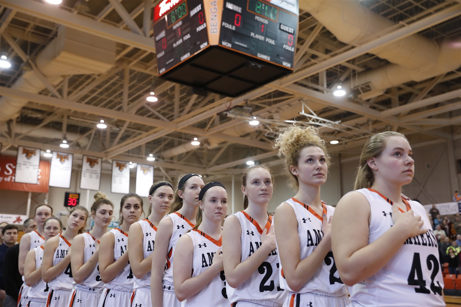 Amherst players stand for the national anthem prior to playing Pittsford Mendon for the New York State A Far West Regional Championship at the Buffalo State Sports Arena on Saturday, March 11, 2017.