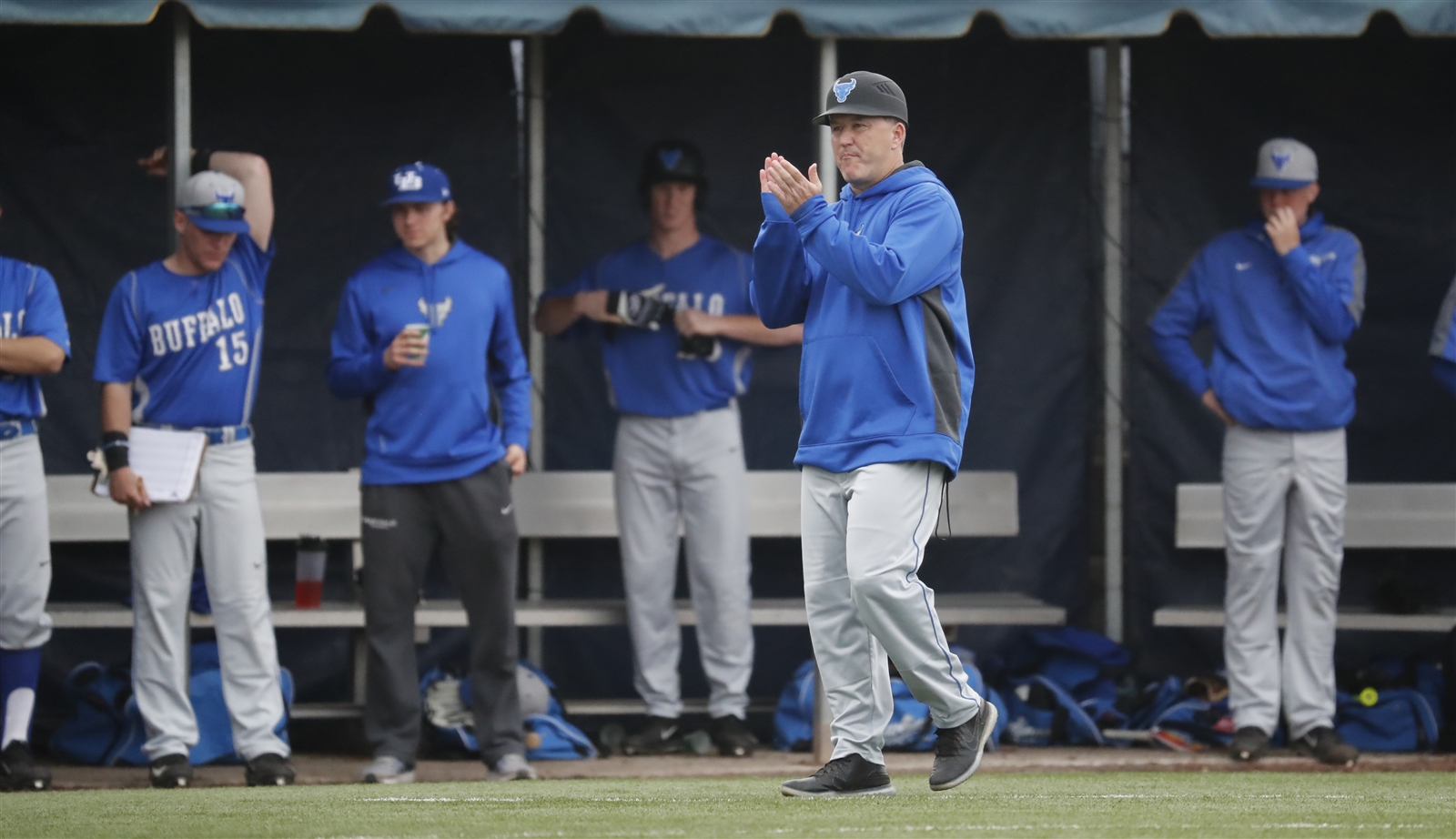 University at Buffalo coach Ron Torgalski cheers on his team against Canisius.