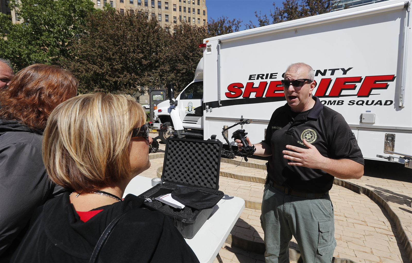 Erie County Sheriffu2019s Deputy Dan Walczak describes a Recon Scout Robot to folks during an outdoor showcase of area law enforcement equipment in Niagara Square in Buffalo Wednesday, June 7, 2017.