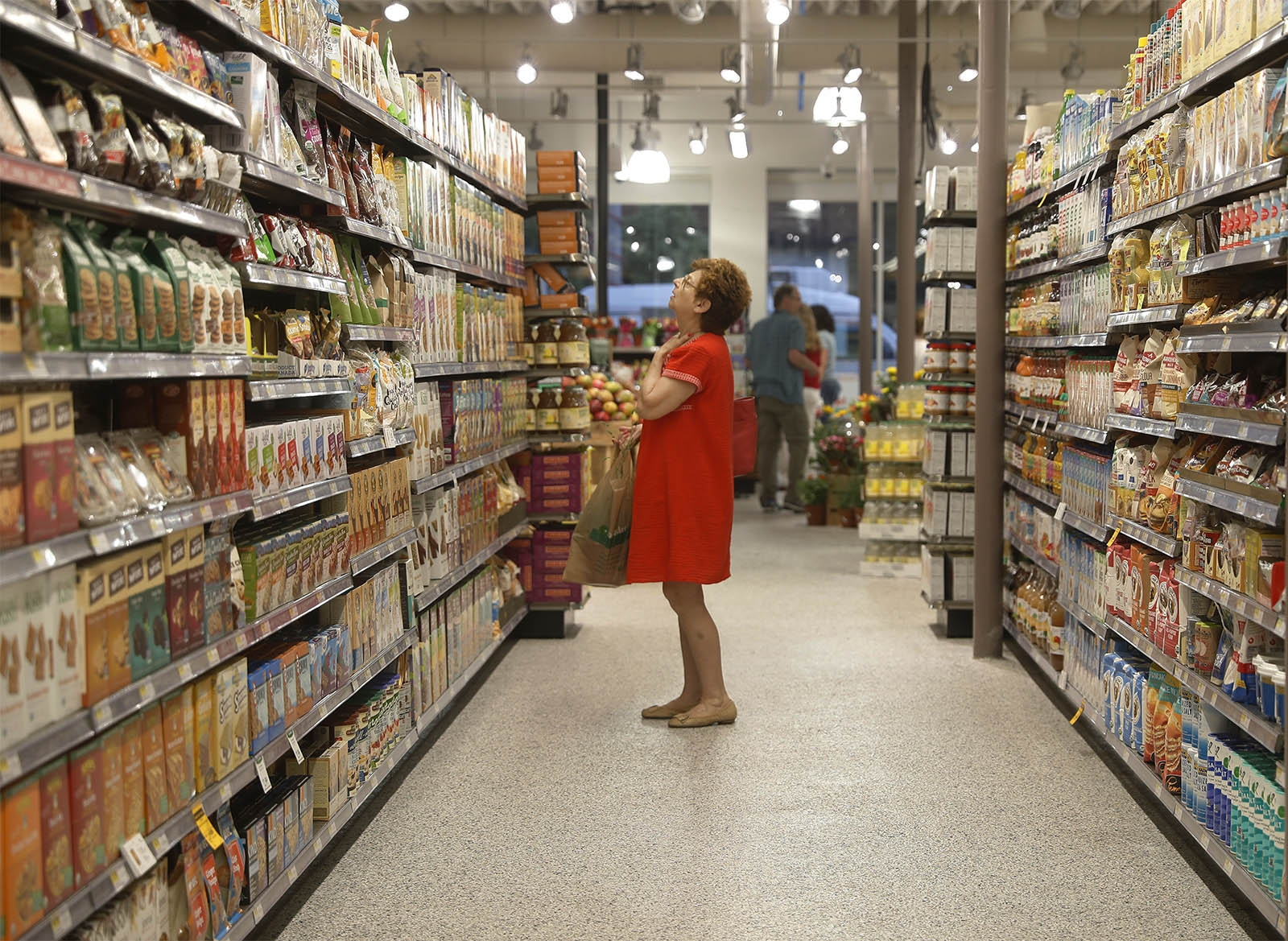 Toni Tripi of Buffalo shops at the Lexington Co-op's second location at 1678 Hertel Ave., which opened July 12.