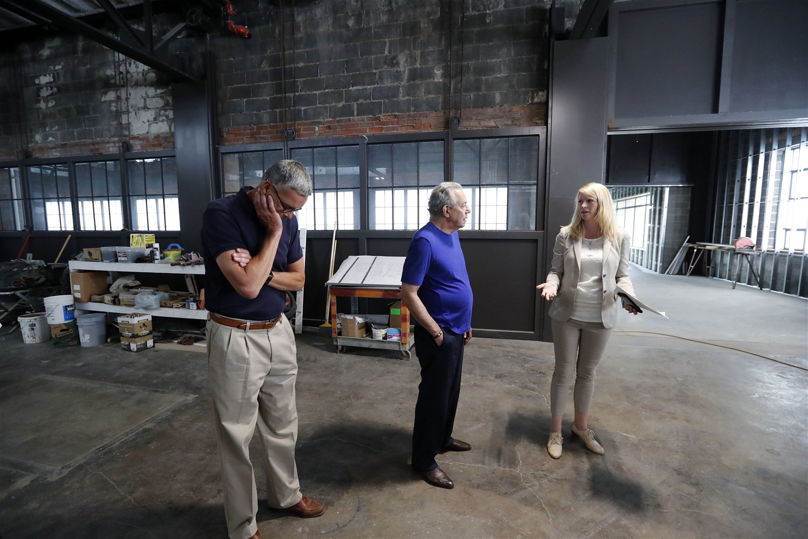 Journey Gunderson and Tom Benson of the National Comedy Center in Jamestown, gives a tour of the soon-to-be-completed facility to comedian Lewis Black in the old train station in Jamestown Thursday, August 3, 2017.