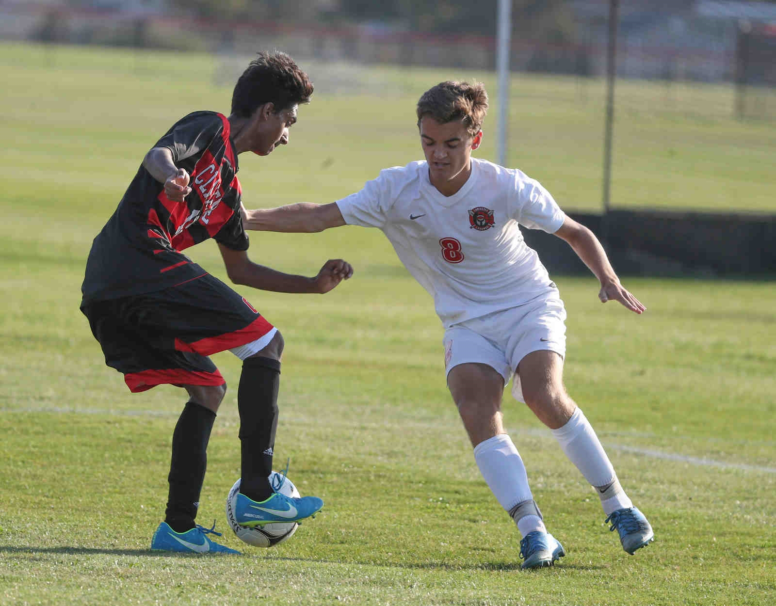 Clarence's Taha Ahmed dribbles the ball past Lancaster's Pat Morin.