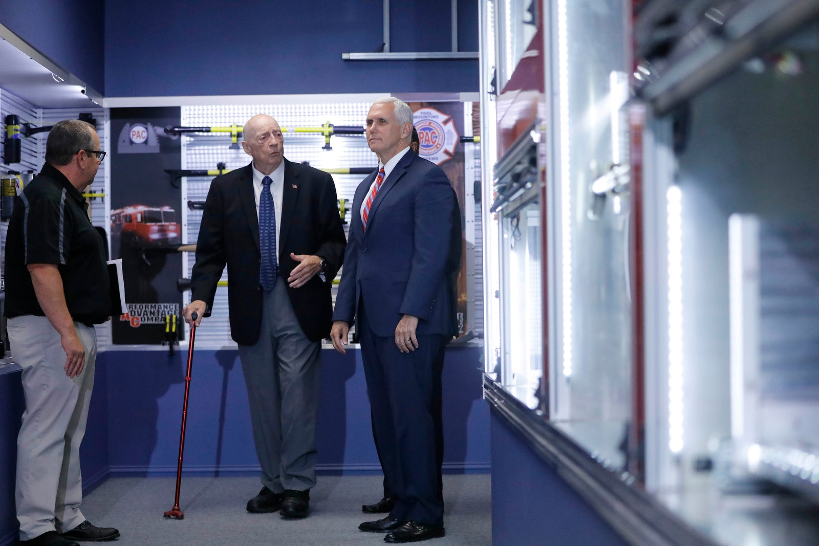 Vice President Pence tours Performance Advantage Company in Lancaster with company founder Dick Young, center, and company President Jim Everett, Tuesday, Oct. 17, 2017.