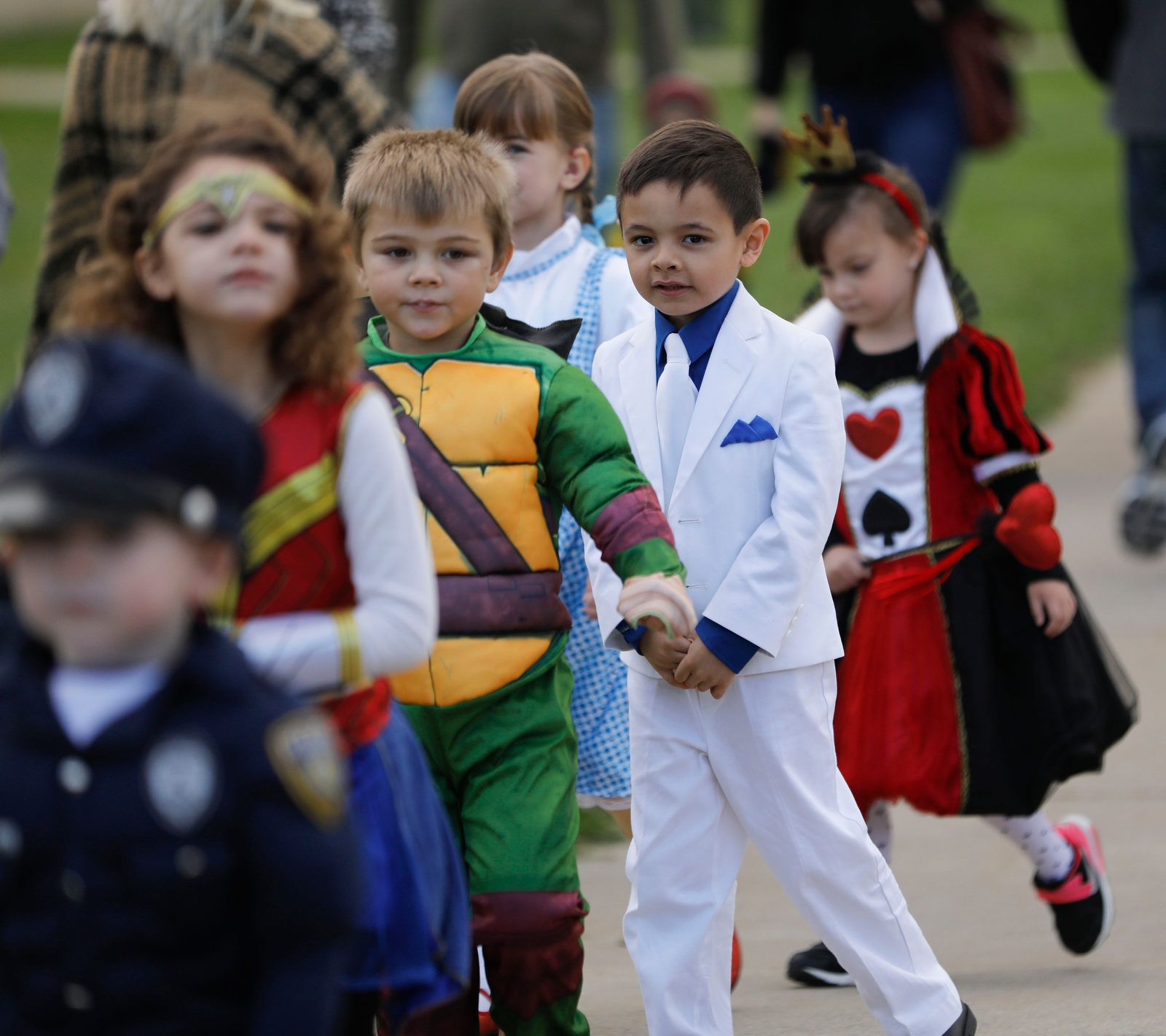 Children in the universal pre-K and kindergarten classes at Lew-Port Primary Education Center parade around the school.