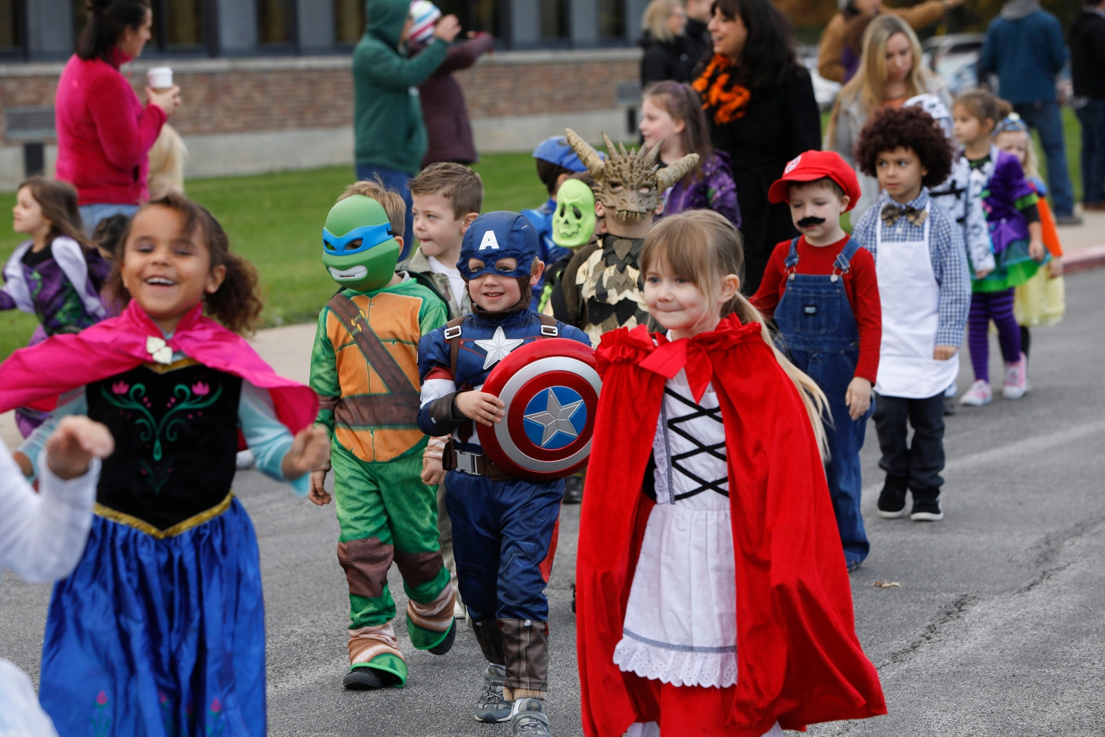Children in the universal pre-K and kindergarten classes at Lew-Port Primary Education Center parade around the school in costume during the Halloween parade, Tuesday, Oct. 31, 2017.