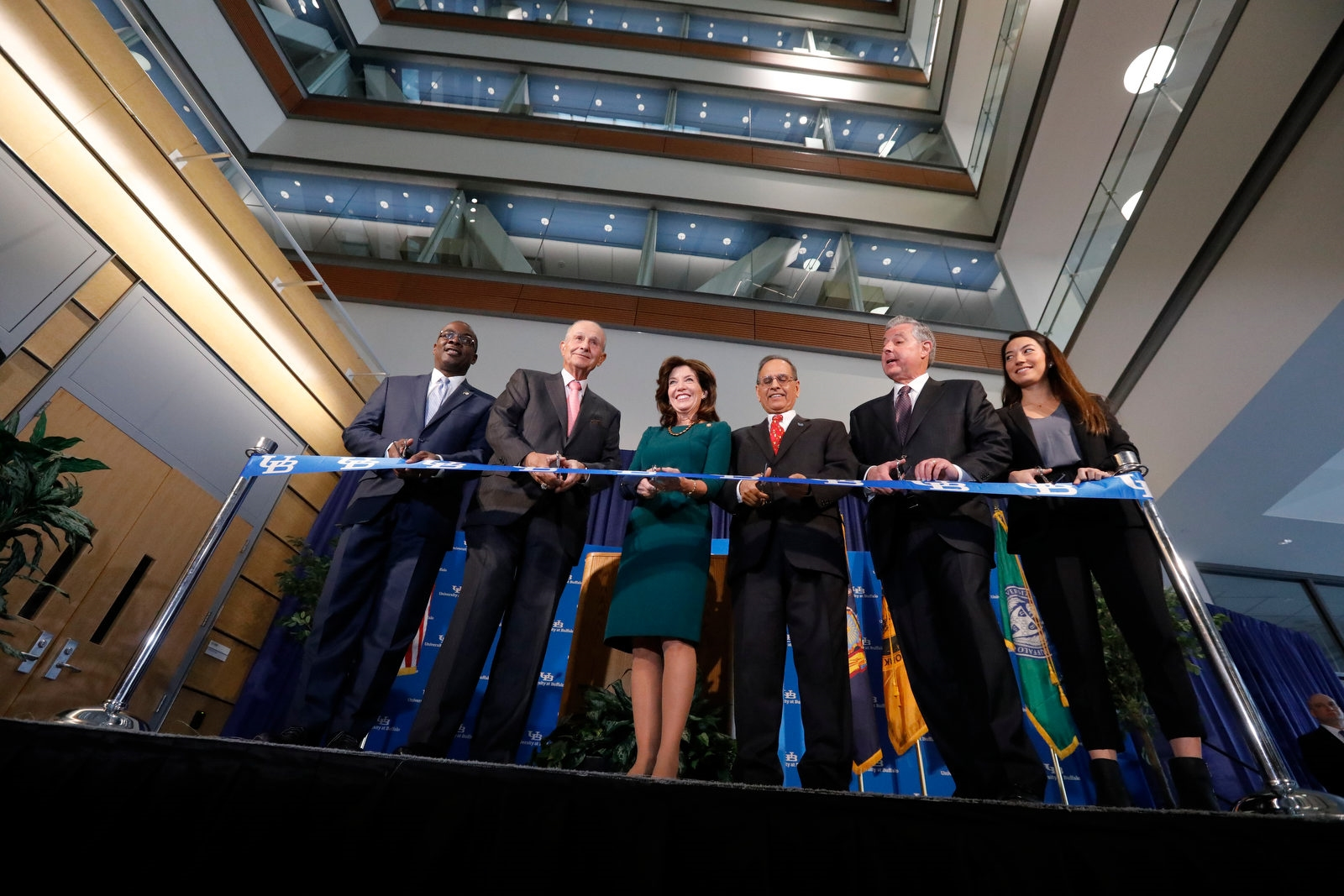 Dignitaries cut the ribbon for the new UB Jacobs School of Medicine and Biomedical Sciences, Tuesday, Dec. 12, 2017.  From left are Buffalo Mayor Byron Brown, Delaware North Chairman Jeremy Jacobs, Lt. Gov. Kathy Hochul, UB President Satish Tripathi, med school Dean Michael Caine and 2nd year student Laura Reed.