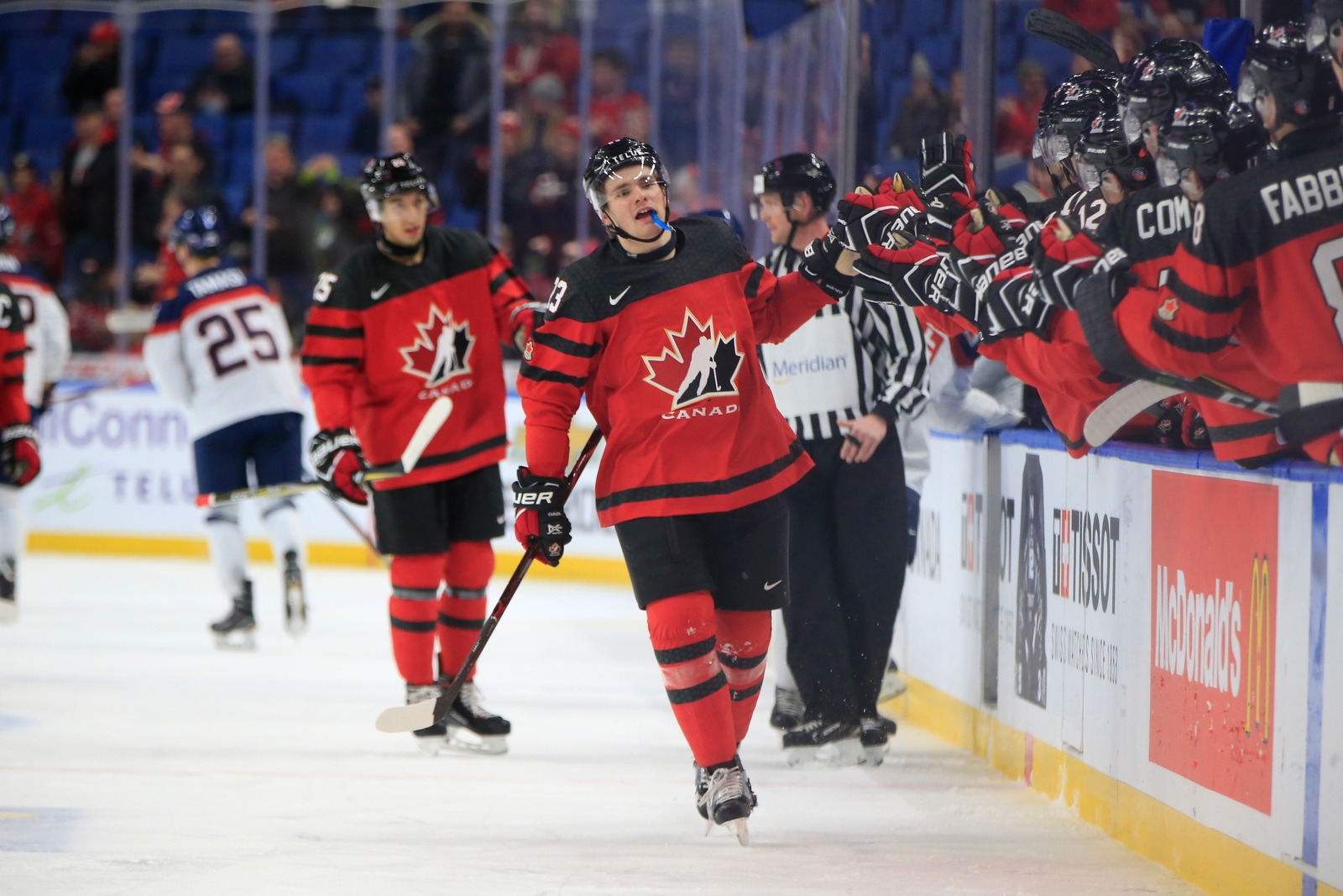 Team Canada forward Sam Steele celebrates his goal with the bench against Slovakia during the first period of their World Junior Hockey  Championship preliminary-round contest on Wednesday, Dec. 27, 2017, at KeyBank Center.