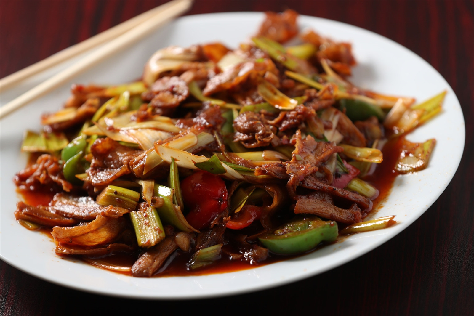 The double-cooked pork is made with stir-fry pork aith leeks, green peppers and red peppers with Sichuan spicy sauce.