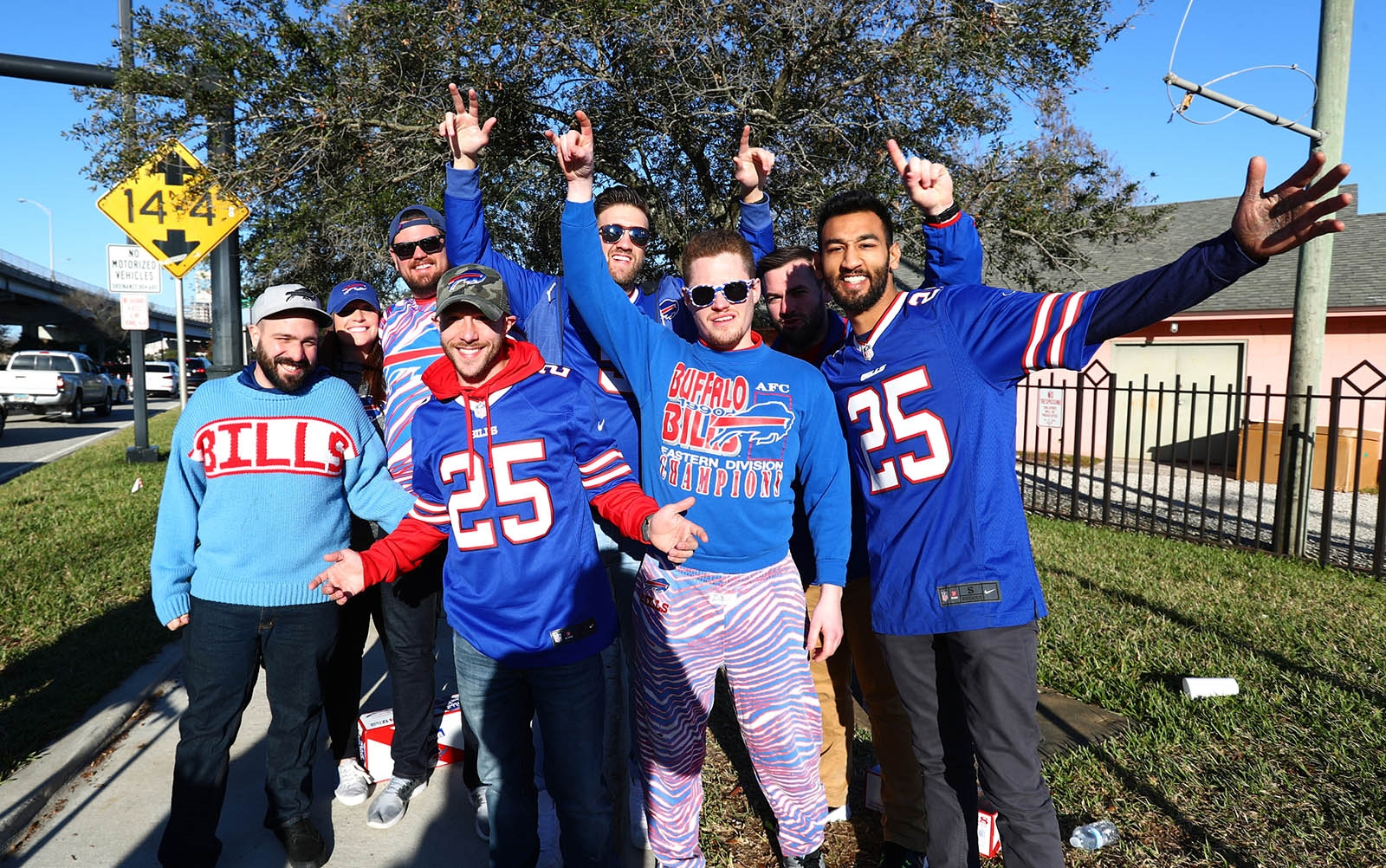 Bills fans tailgate in the EverBank Field parking lot.