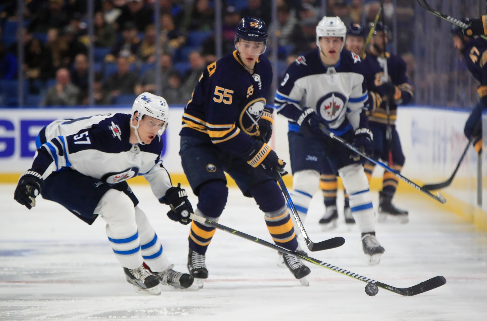 Buffalo Sabres' Rasmus Ristolainen tips the puck past Winnipeg Jets' Tyler Myers during first period action at the KeyBank Center on Tuesday, Jan. 9, 2018.