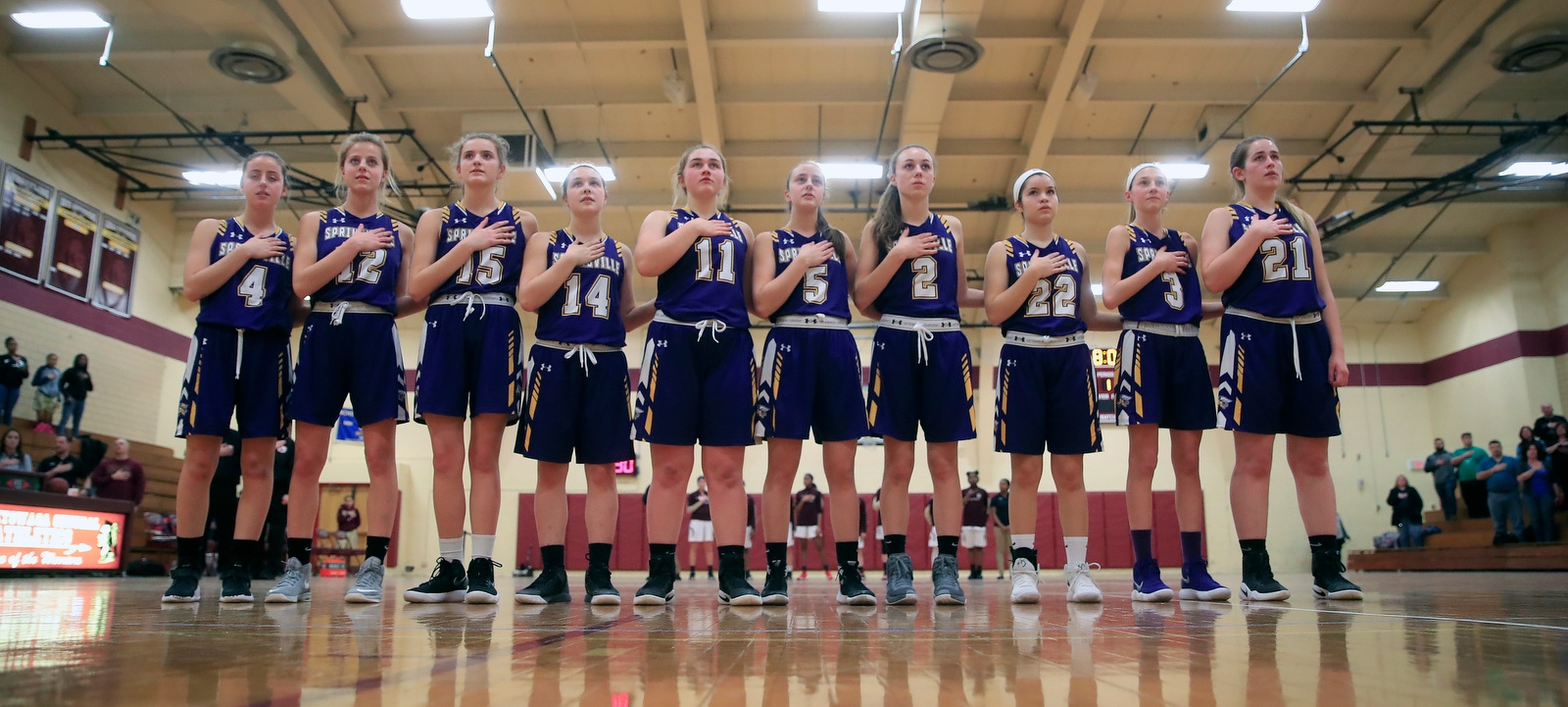 Springville players stand for the pledge prior to playing Cheektowaga.