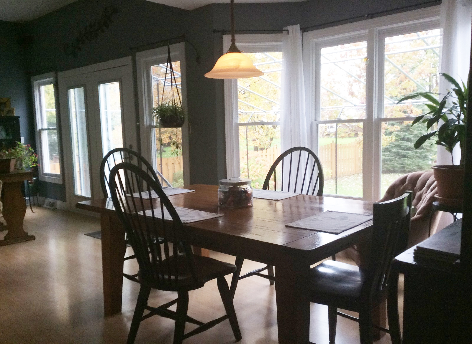 Another view of the dining room, which is furnished with a farmhouse-style table.