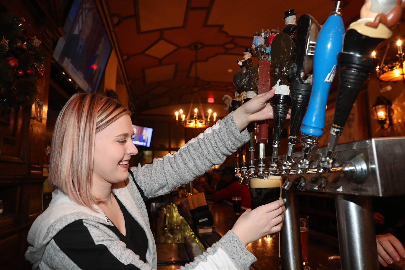 Bartender Christa DiSiglia pours their Rough Rider porter. Except for Labatt Blue and Blue Light drafts and bottles, all the beers are made in house.