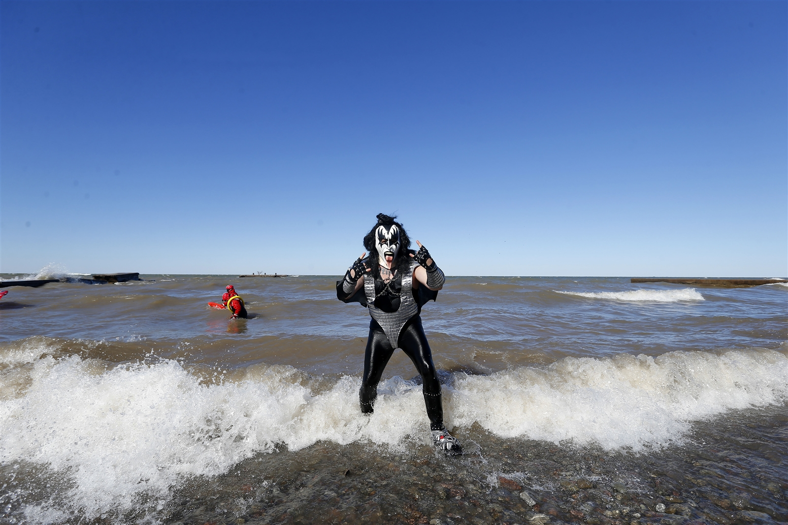 Dressed as Gene Simmons from the rock band Kiss, Terry Broeker of Lewiston, takes to the frigid waters of Lake Ontario for the 49th Annual Polar Bear Swim For Sight, sponsored by the Olcott Lions Club, at Olcott Beach on Sunday, March 4, 2018.