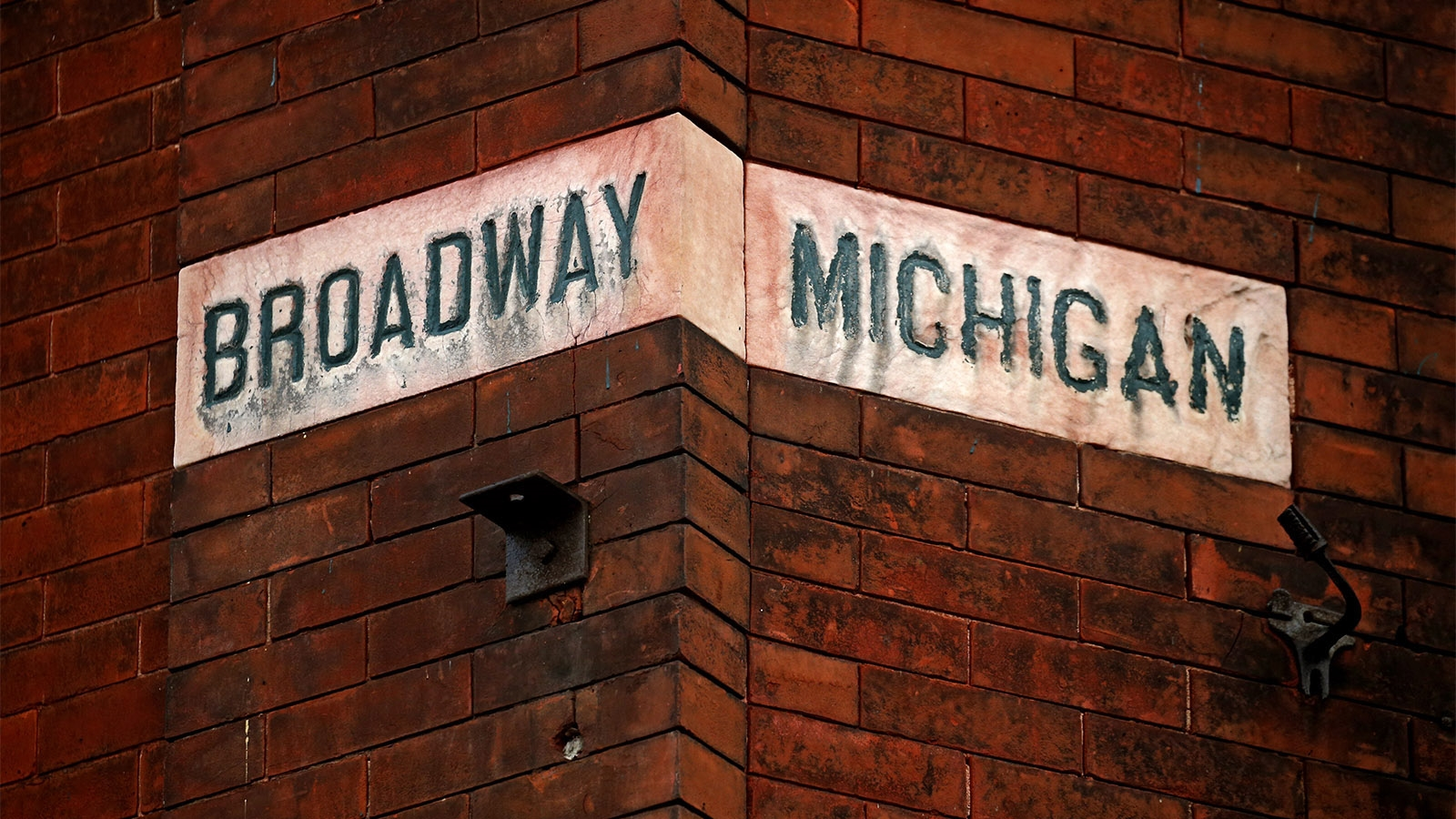 Day 174: June 23, 2018 - An old stone street sign embedded in the brick on the corner of the building  at Michigan and Broadway.  The building is slated to become the Nash Lofts.